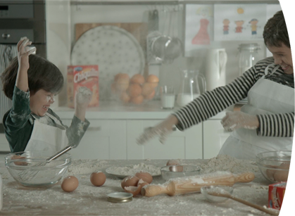 Mother and son playing with flour in the kitchen